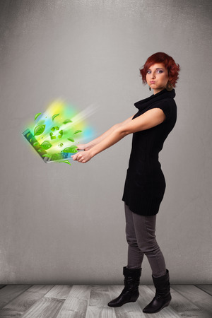 Casual young woman holding notebook with recycle and environmental symbols photo
