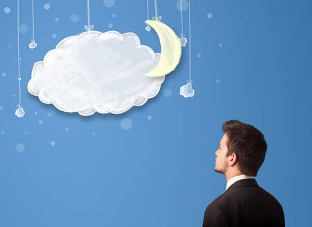 Businessman looking at cartoon night clouds with moon hanging down Stock Photo