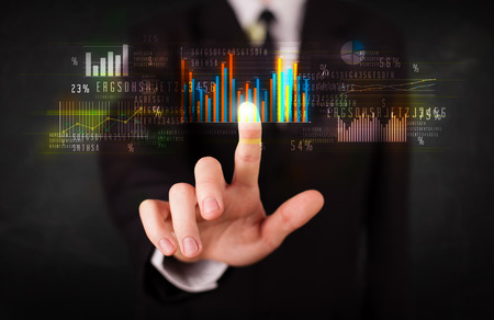 information button: Business person touching colorful charts and diagrams Stock Photo
