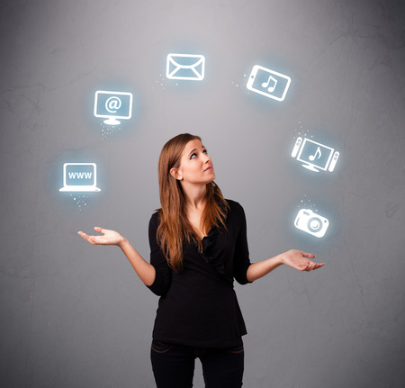 electronic balance: pretty girl standing and juggling with elecrtonic devices icons