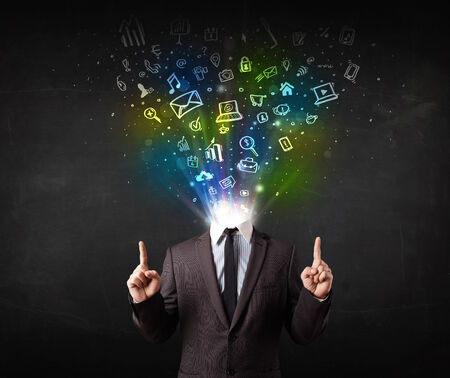 Business man with glowing media icons exploding head concept photo