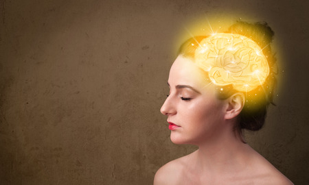 Young girl thinking with glowing brain illustration on grungy background
