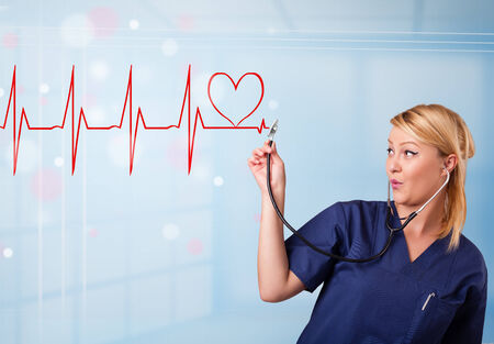 electrocardiograph: Beautiful young nurse listening to abstract pulse with red heart Stock Photo