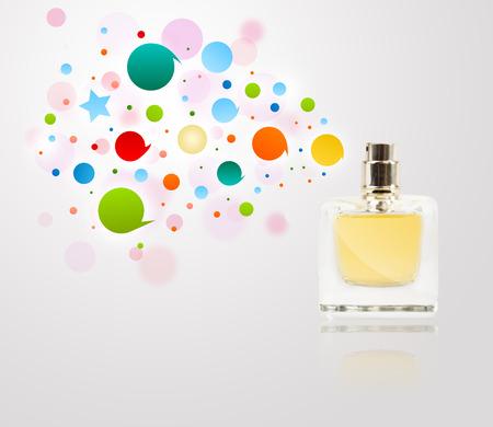 parfum: Perfume bottle spraying colorful bubbles