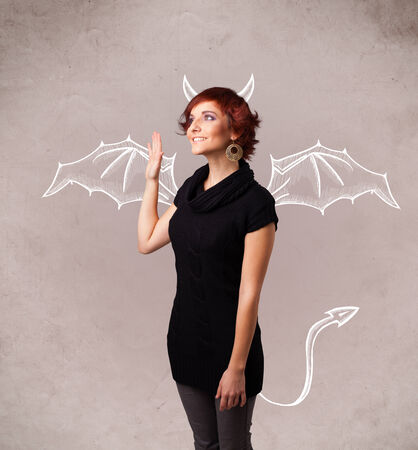 nasty: Young nasty girl with devil horns and wings drawing Stock Photo