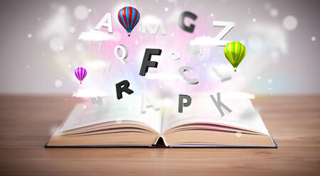 knowledge business: Open book with flying 3d letters on concrete background. Colorful education concept Stock Photo