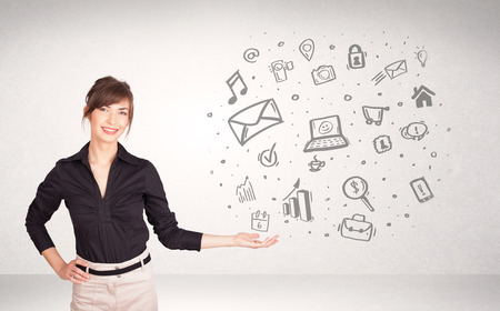 Young business woman presenting hand drawn media icon cloud photo