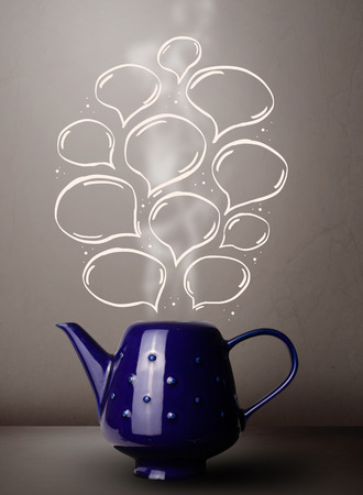 Coffee pot with hand drawn speech bubbles, close up photo