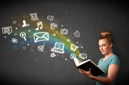 Young lady reading a book with multimedia icons coming out of the book photo