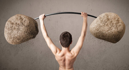 twiggy: Funny skinny guy lifting large rock stone weights