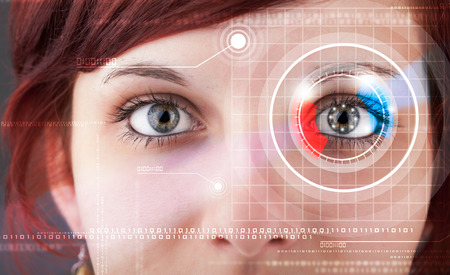 Modern cyber woman with technolgy eye looking Stock Photo
