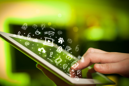 tablet pc in hand: Hand touching tablet pc, social media concept