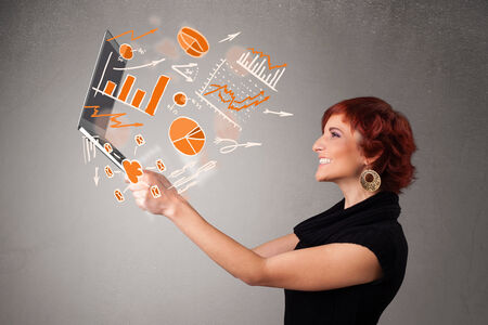 analyst: Beautiful young lady holding laptop with graphs and statistics Stock Photo