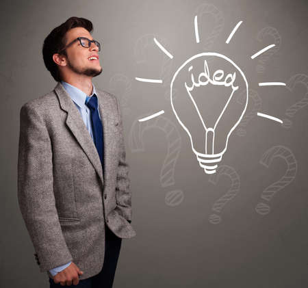 theorize: Attractive young boy comming up with a light bulb idea sign