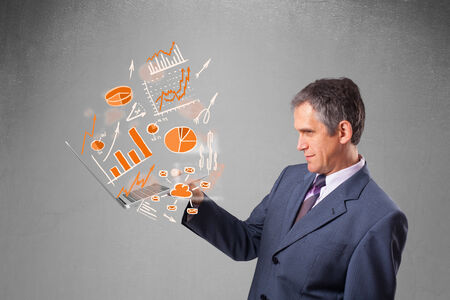 Businessman in suit holding notebook with graphs and statistics photo