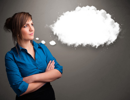 theorize: Pretty young lady thinking about cloud speech or thought bubble with copy space