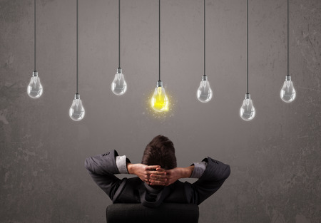 idea light bulb: Businness guy in front of bright idea light bulbs concept Stock Photo