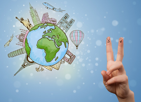 Cheerful happy smiling fingers with famous landmarks of the globe photo