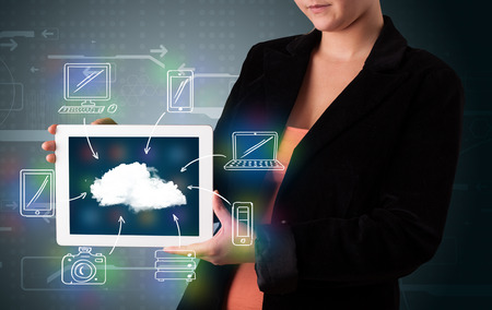 Young woman showing hand drawn cloud computing photo