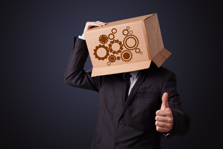 spur: Young man standing and gesturing with a cardboard box on his head with spur wheels