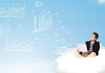 Young businessman sitting in cloud with laptop, charts concept photo