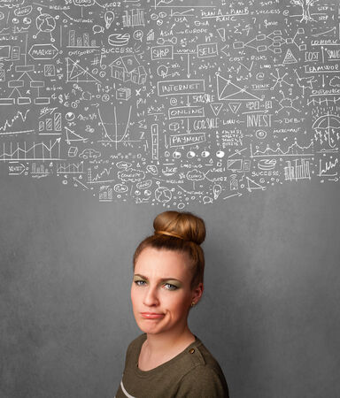 Thoughtful young woman with sketched charts over her head photo