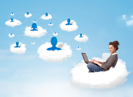 sitting pretty: Pretty young woman sitting in cloud with laptop, social network concept