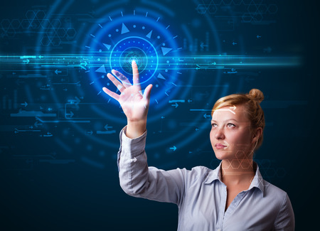 Tech woman pressing high technology control panel screen concept  photo