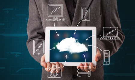 Young businessman showing hand drawn cloud computing photo