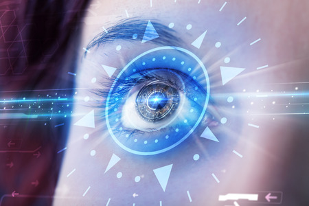 cyber girl: Modern cyber girl with technolgy eye looking into blue iris