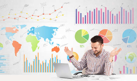 Business man with colorful charts graphs photo