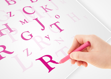 testament schreiben: Human Hand schriftlich verschiedene Buchstaben auf wei�em Normalpapier Lizenzfreie Bilder
