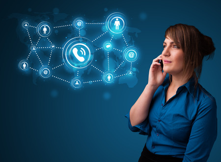 Pretty young girl making phone call with social network icons photo