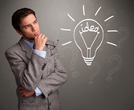 Attractive young boy comming up with a light bulb idea sign photo