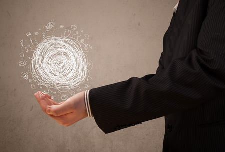 chaos: Businessman presenting chaos concept in her palm Stock Photo