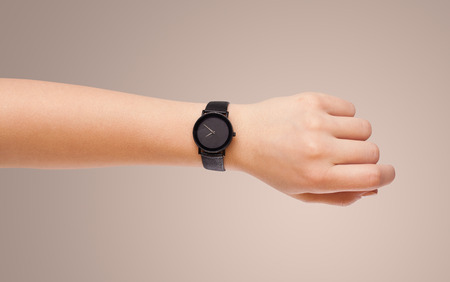 Hand with modern watch showing precise time Stock Photo