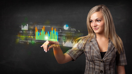 Business woman touching colorful charts and diagrams photo