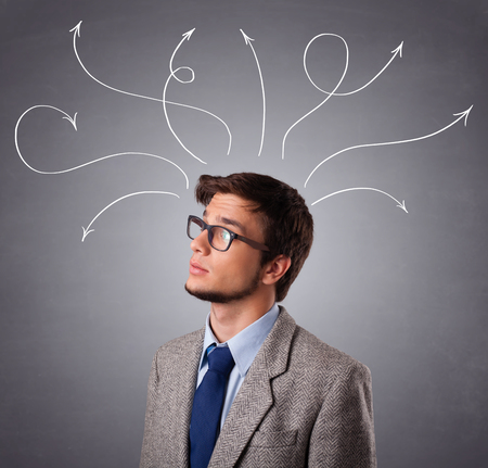 handome: Attractive young man thinking with arrows overhead