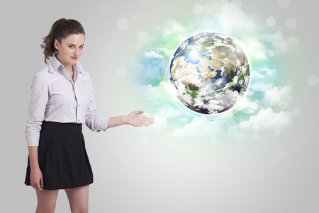 Young business woman with earth and cloud concept photo