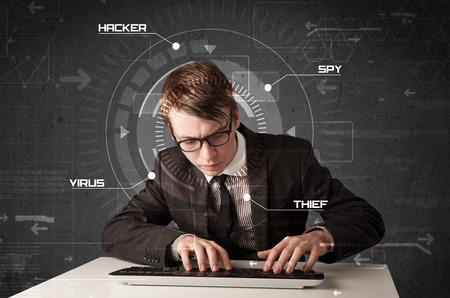 tecnologia informacion: Hacker de joven en ambiente futurista hackear informaci�n personal sobre fondo de alta tecnolog�a Foto de archivo