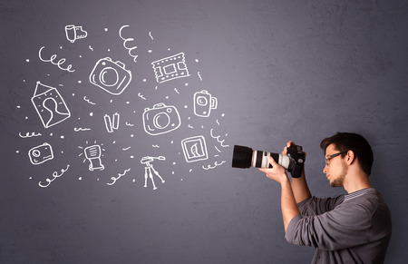 human photography: Attractive young photographer shooting photography icons