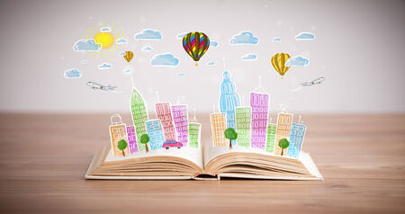 Colorful cityscape drawing on open book photo