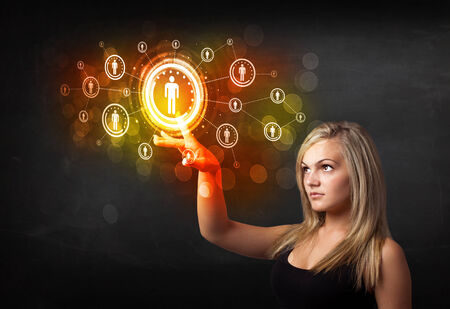 Young woman touching future technology social network button photo
