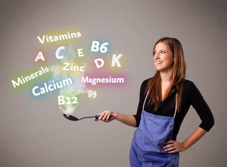 vitamina a: Bastante joven mujer cocina vitaminas y minerales