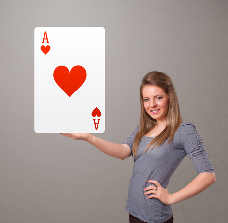 beautifu: Beautifu young woman holding a red heart ace Stock Photo
