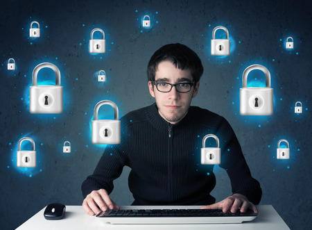 internet attack: Young hacker with virtual lock symbols and icons on blue background