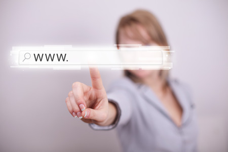 address bar: Young woman touching web browser address bar with www sign