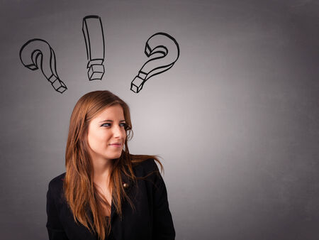 query mark: Beautiful young lady thinking with question marks overhead Stock Photo