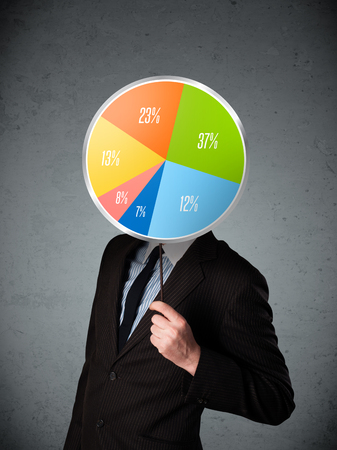 hidden success: Businessman holding a colorful pie chart in front of his head Stock Photo