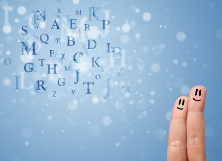 mixture: Happy cheerful smiley fingers looking at mixture of bokeh letters Stock Photo